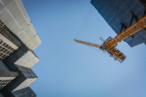 Cranes and scaffolding at a construction site in Bangkok, Thailand – zdjęcie