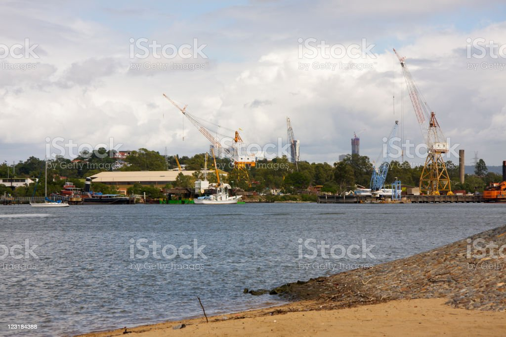 Cranes and Watercraft on the Brisbane River royalty-free stock photo
