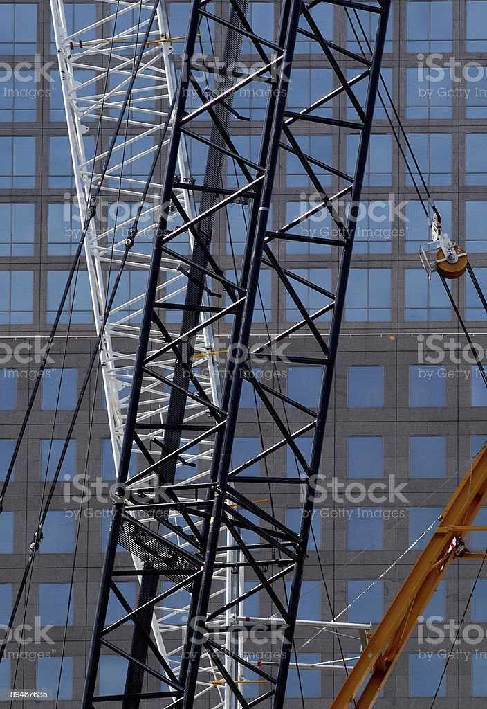 cranes at a construction site, NYC royalty-free stock photo