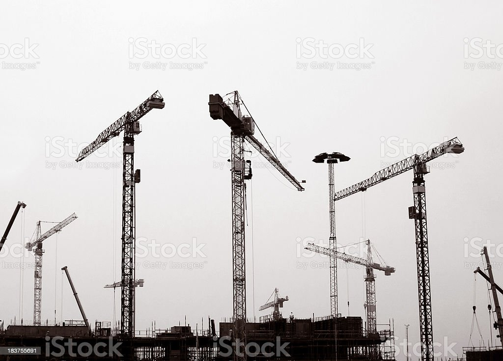 Cranes at a construction site stock photo