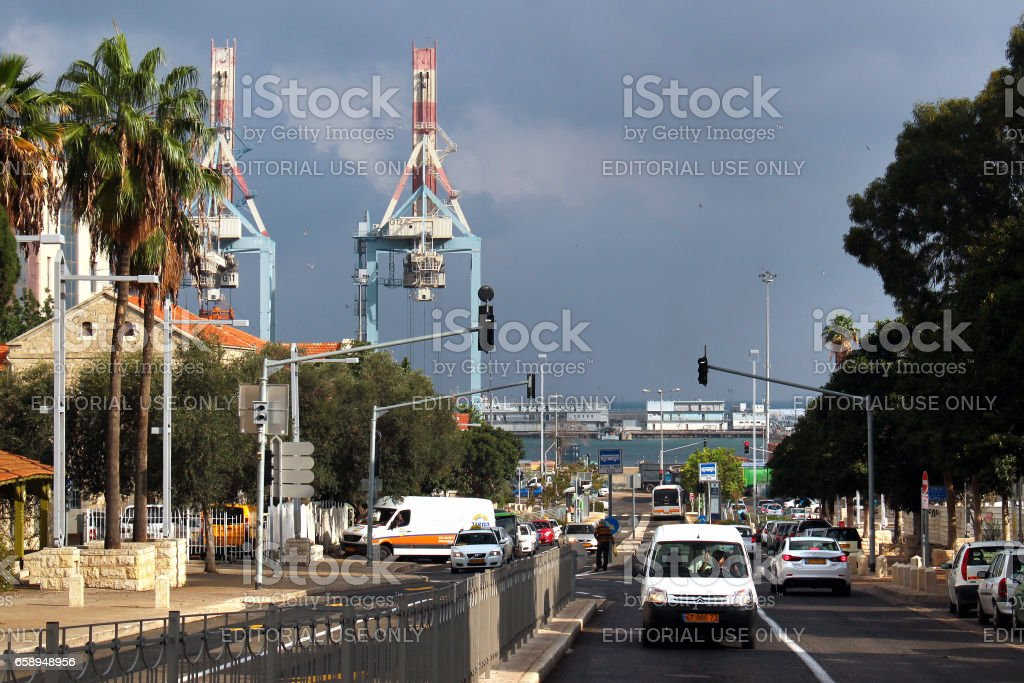 Cranes at Haifa port seen from central Ben Gurion boulevard in downtown Haifa stock photo
