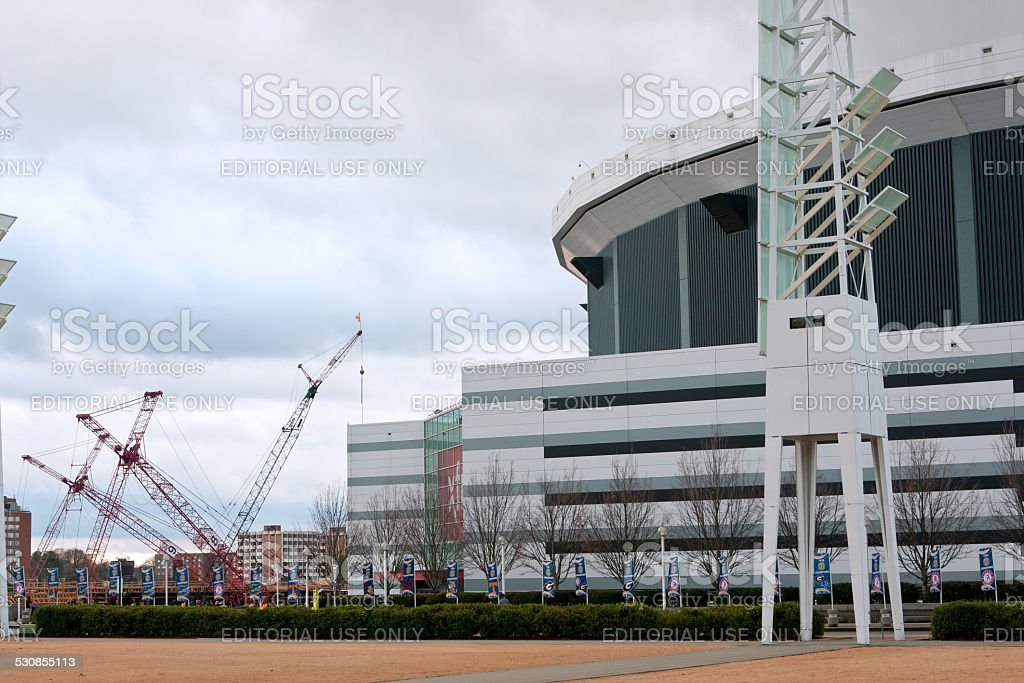 Cranes At New Stadium Site Sit Next To Georgia Dome stock photo