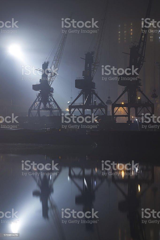 Cranes at night royalty-free stock photo