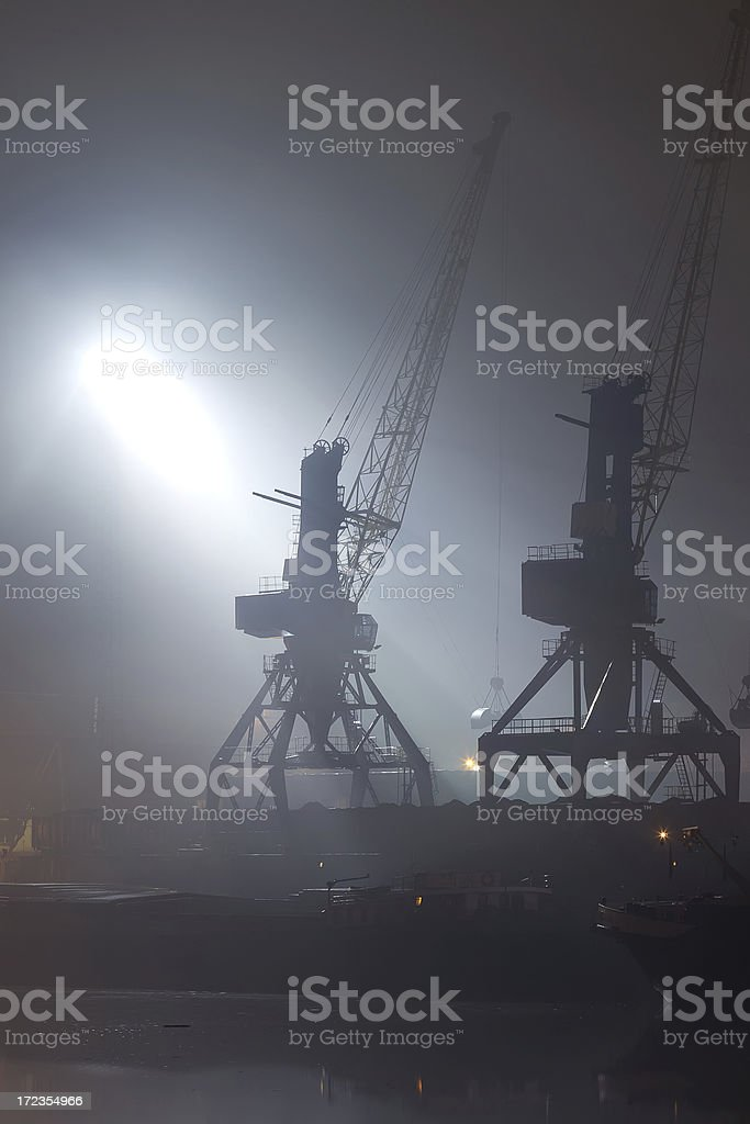 Cranes at night royalty-free stock photo
