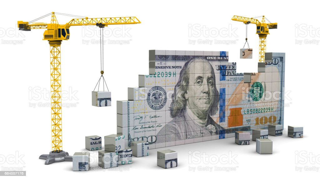 cranes building money stock photo