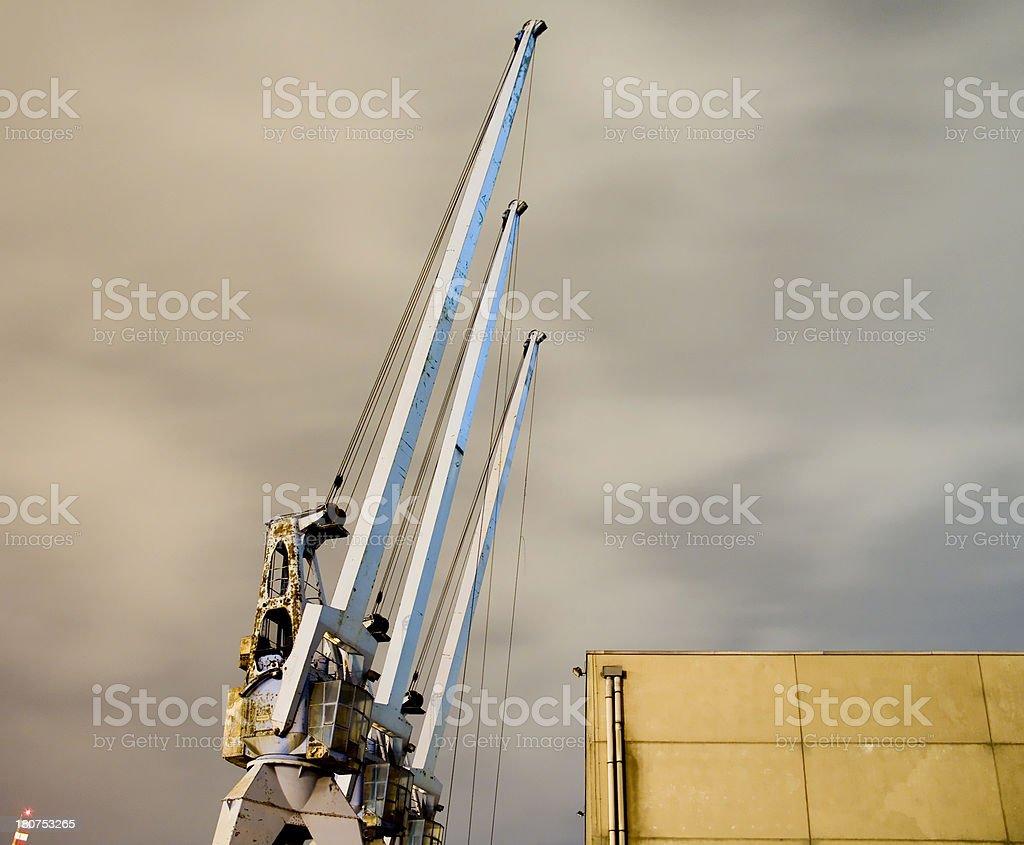 cranes by night stock photo