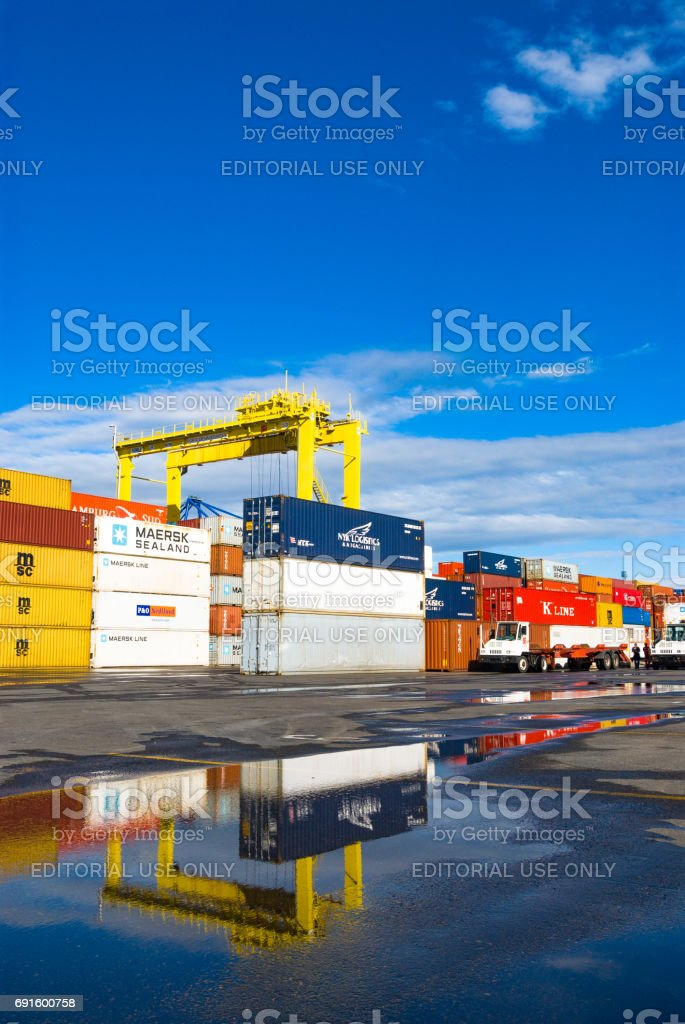 Cranes doing the loading of containers on the ship stock photo