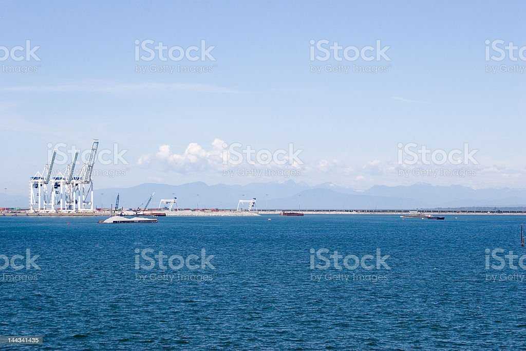 Cranes in Vancouver harbor royalty-free stock photo