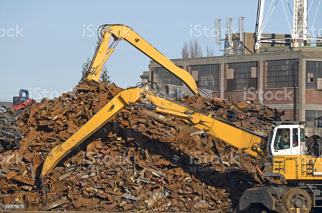 Cranes moving scrap metal at recycler royalty-free stock photo