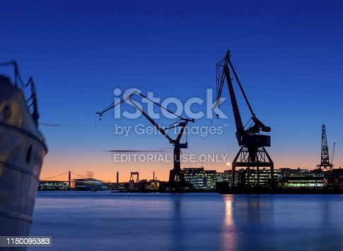 Gothenburg, Sweden - november 2 2017:  Cranes of and old wharf in a beautiful sunset.
