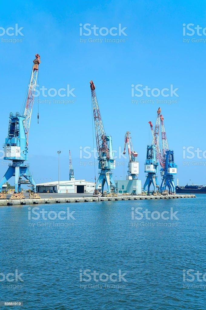 Большие краны на пристань Стоковые фото Стоковая фотография