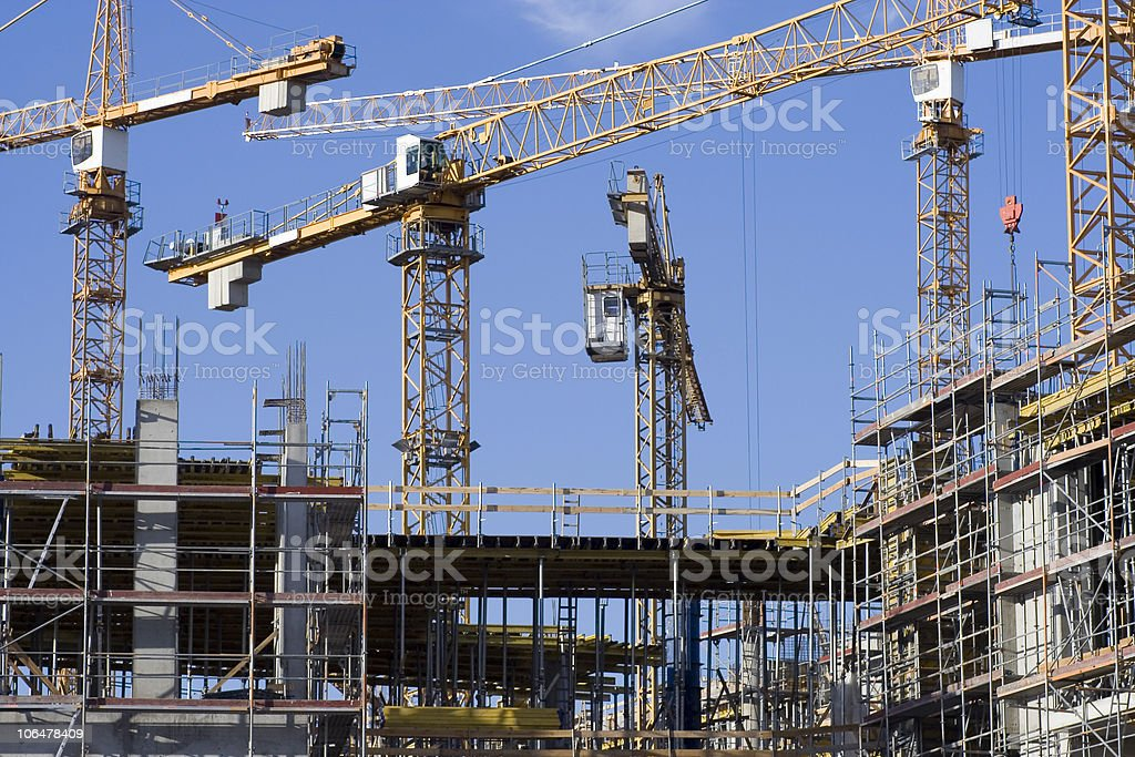 Cranes on a construction site. stock photo
