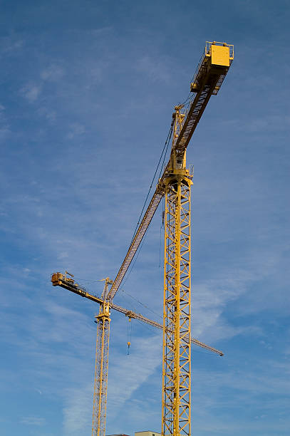 Cranes on a construction site stock photo
