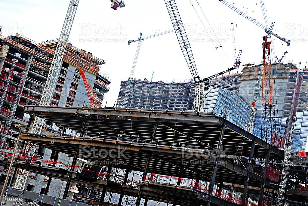 Cranes on a skyscrapers construction site stock photo