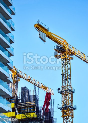 istock Cranes on construction site 1073982044