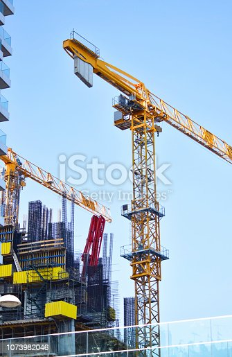 istock Cranes on construction site 1073982046