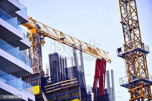 istock Cranes on construction site 1073982048