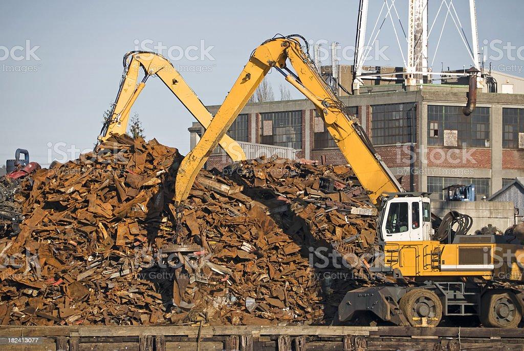 Cranes sorting scrap metal at recycler royalty-free stock photo