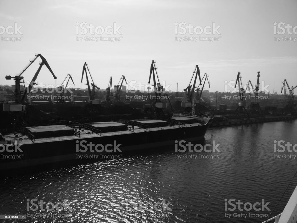 Cranes unloading charcoal att Riga harbour stock photo