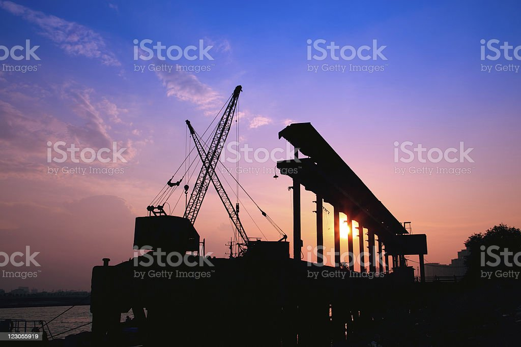 Cranes working at sunset royalty-free stock photo