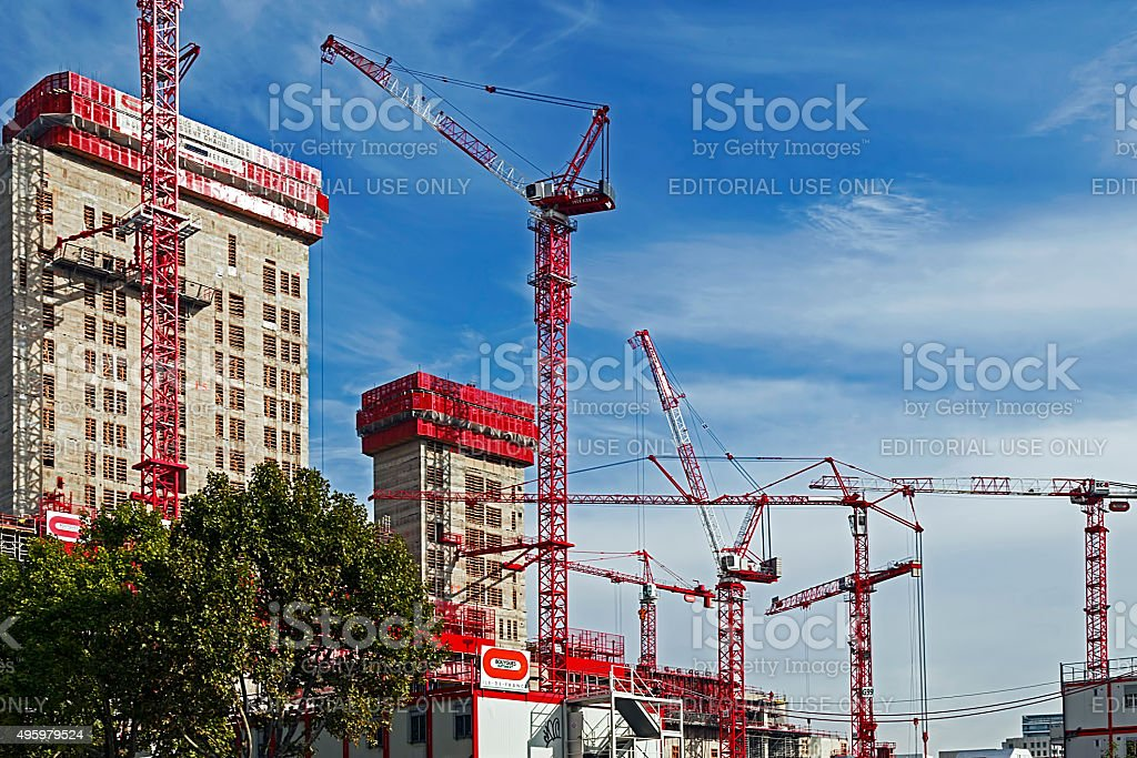 Cranes works and multistorey building stock photo
