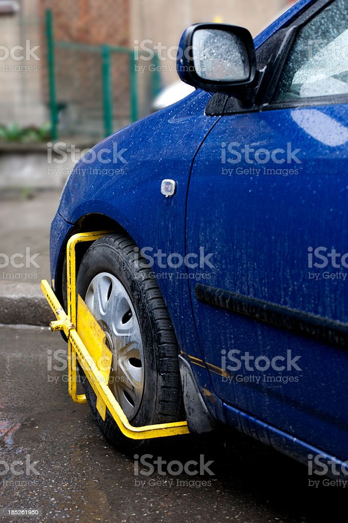 craped car wheel in restrcted area stock photo