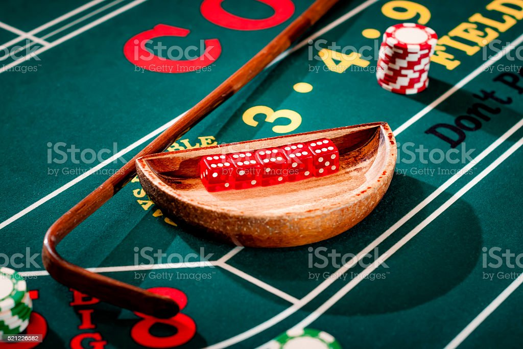 Craps table with a set of dice, stick and chips stock photo