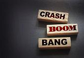 istock Crash boom bang words on wooden blocks on black. crisis concept 1262179852