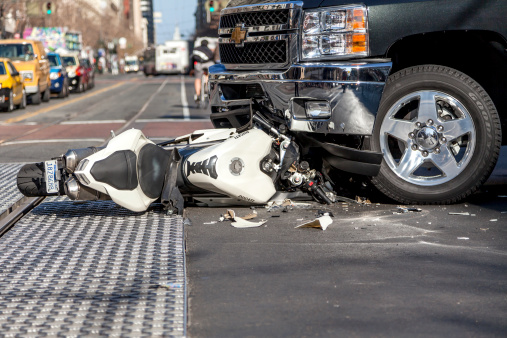 San Francisco, USA - January 23, 2014: A bad traffic accident between a white Ducati motorcycle and Chevy pickup truck occurred on Market street in the late afternoon and brought traffic to a halt, backing up Muni buses and light rain trains. No fatalities were reported.