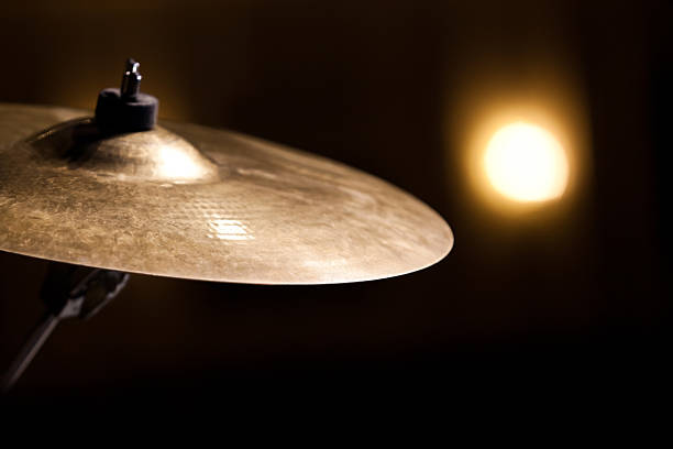 Crash Ride cymbal  Crash Ride cymbal on a black background cymbal stock pictures, royalty-free photos & images
