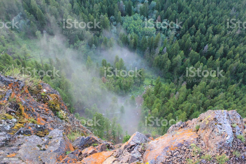 Crash site from mountain in a foggy forest stock photo