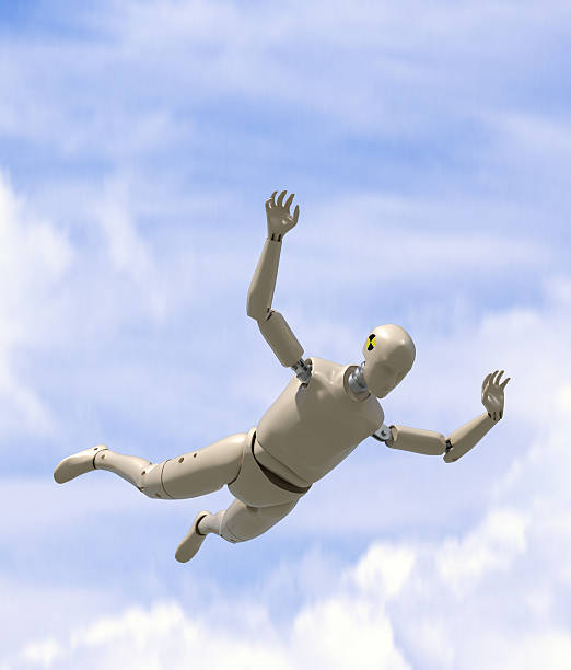 Crash test dummy goes sky diving. stock photo