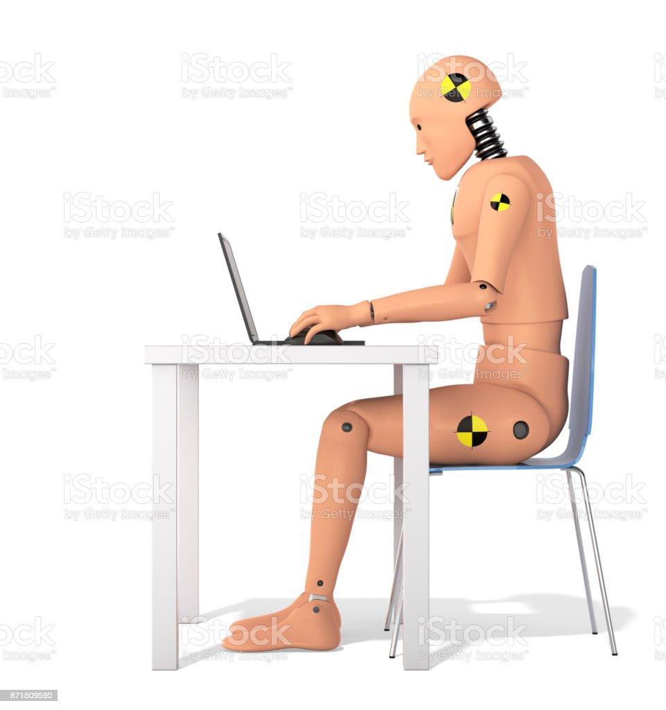 Crash Test Dummy Using Laptop stock photo