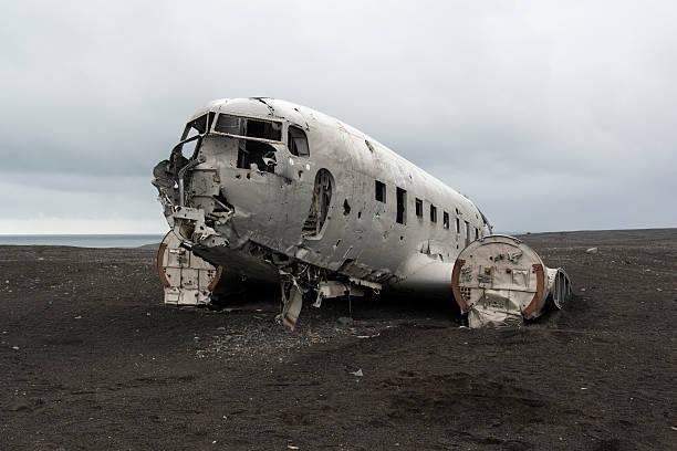 Crashed airplane Douglas on a black sand beach, Iceland Crashed airplane Douglas on a black sand beach, Iceland sólheimasandur stock pictures, royalty-free photos & images