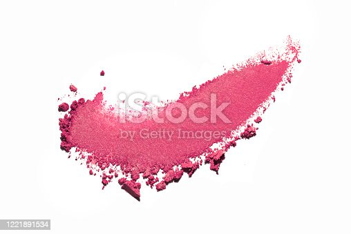 Crashed smudged multi-colored grey eye shadow powder crumpled trampled on white isolated background