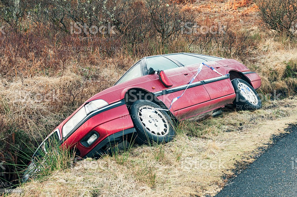 Crashed Car in a Ditch stock photo