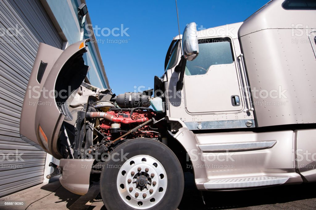 Crashed in car accident big semi truck stock photo