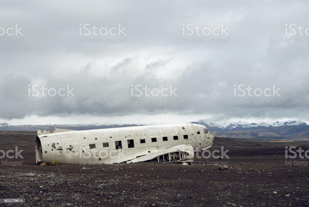 Crashed military plane in black sand Solheimasandur beach stock photo