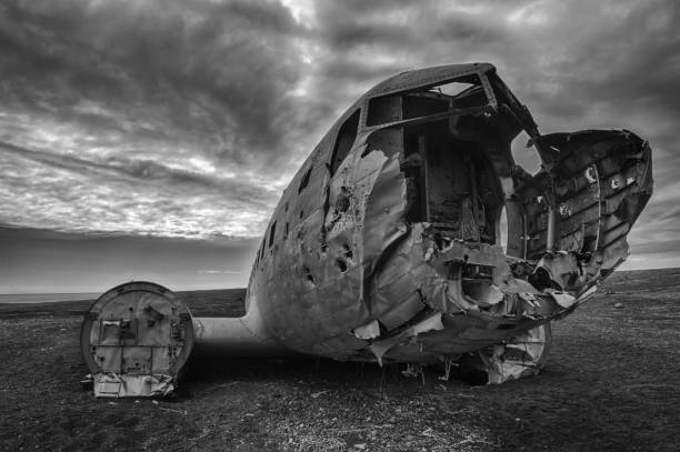 Crashed palne Wreck of a US military plane crashed in the middle of the nowhere. The plane ran out of fuel and crashed in a desert not far from Vik, South Iceland in 1973. The crew survived. It is a famous site to visit nowadays, but hard to find. sólheimasandur stock pictures, royalty-free photos & images