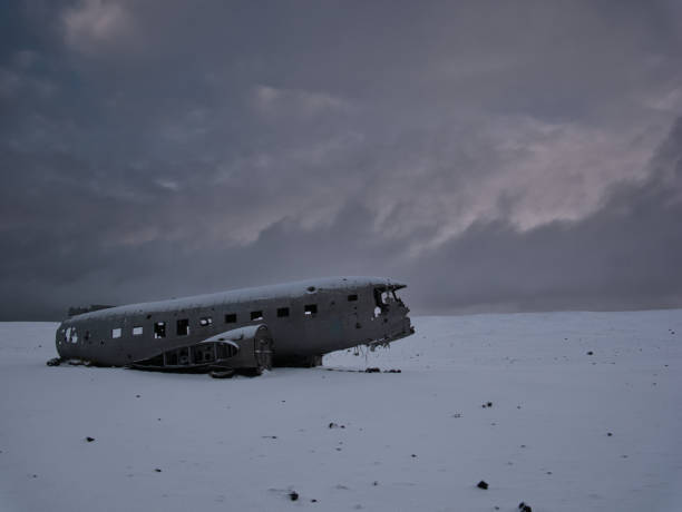 Crashed plane on a snowy field in iceland Crashed plane on a snowy field. Photo from March in Iceland sólheimasandur stock pictures, royalty-free photos & images