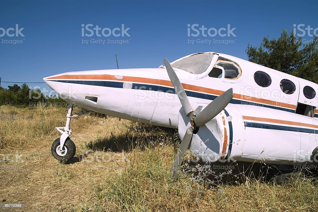 crashed propeller plane on field royalty-free stock photo