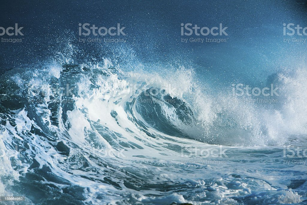 Crashing blue and white waves in the ocean stock photo