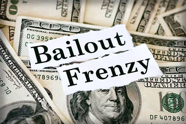 crashing Hundred dollar bills with the words bailout frenzy. bailout stock pictures, royalty-free photos & images