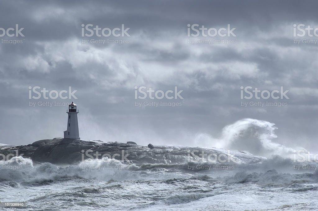 Crashing wave lighthouse royalty-free stock photo