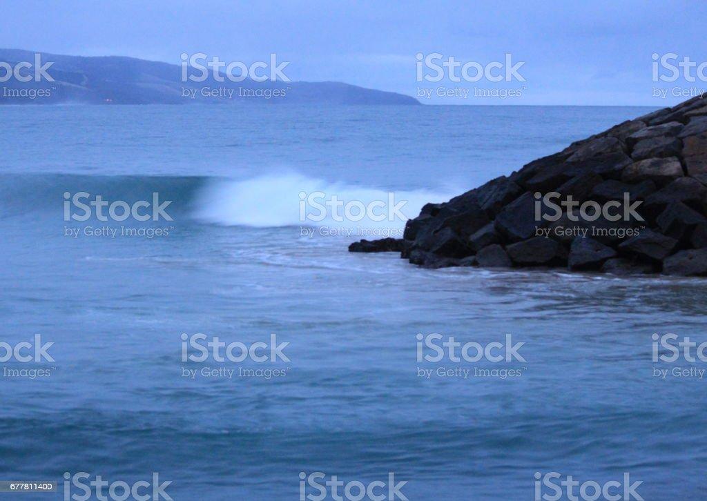 crashing waves on the rock royalty-free stock photo