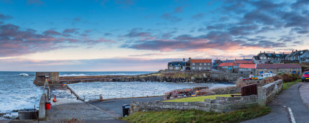 Craster Harbour and Village Panorama stock photo