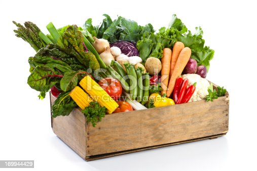 istock Crate filled with assortment of  organic vegetables on white backdrop 169944429