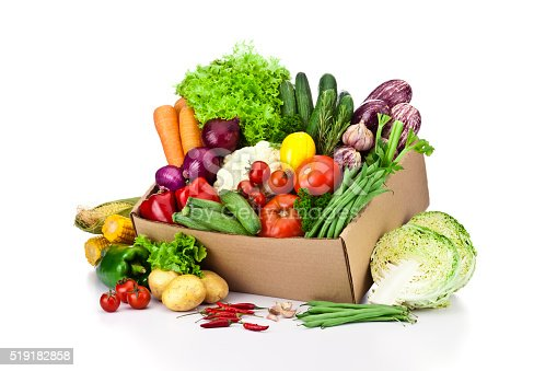 istock Crate filled with assortment of organic vegetables on white backdrop 519182858