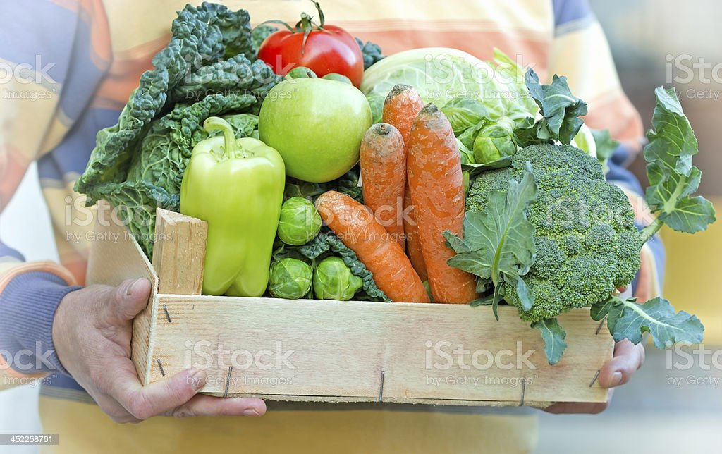 Crate full of fresh healthy, organic food (fruit and vegetable) stock photo