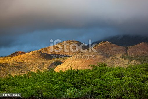 volcanic crater hills in the sun at makena state park on maui island, hawaii islands, usa.